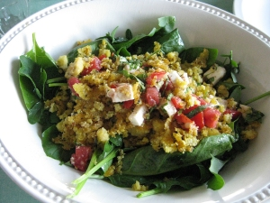 spinach salad with cornmeal crumbs and caprese